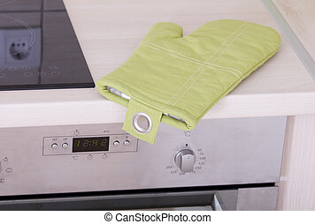 Kitchen protective glove - Green heat protective glove on...