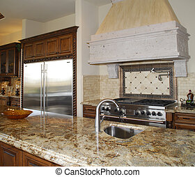 lovely kitchen range and granite counter top