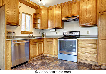 Kitchen room interior with brown tile floor