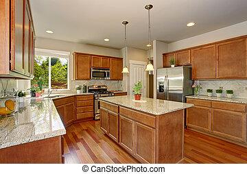 Kitchen room interior with hardwood floor and granite counter top