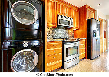 Kitchen room with laundry appliances