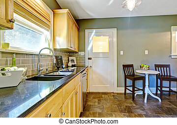 Kitchen And Dining Table With Green Walls And Maple Cabinets Canstock