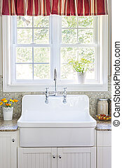 Kitchen sink and counter - Kitchen interior with large...