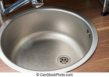 Kitchen sink - empty kitchen sink in a kitchen