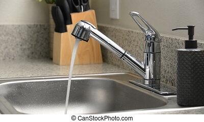 Kitchen sink faucet running water