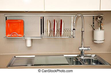 Kitchen sink - Modern kitchen sink with a few dishes,...