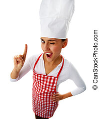 Kitchen staff - Portrait of happy female chef winking to you...