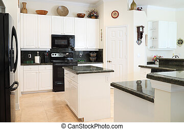Kitchen - View of a beautiful modern kitchen with upscale...