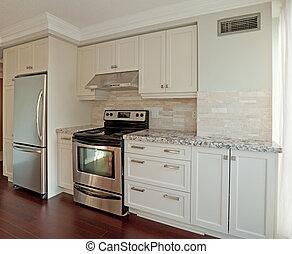 Kitchen - Modern kitchen with marble countertops
