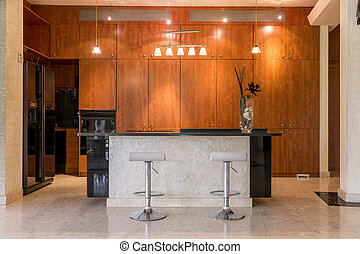 Kitchen surrounded by wooden cabinets