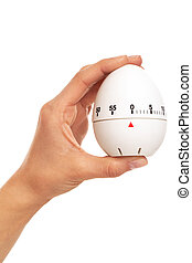 Kitchen timer in woman's hand