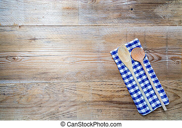 Kitchen towel and wooden spoon background