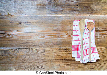 Kitchen towel background with wooden spoons