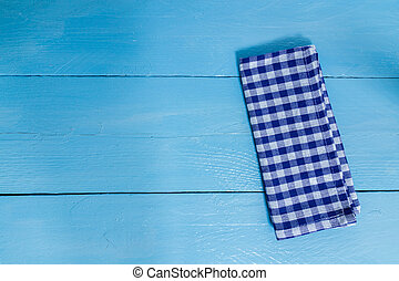 Kitchen towel blue on blue wooden background
