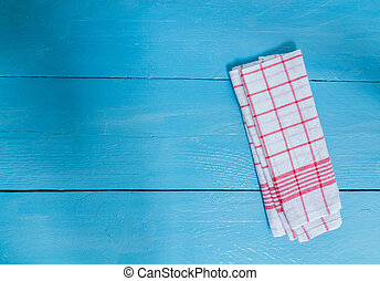 Kitchen towel red on blue wooden background