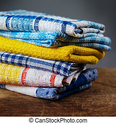 kitchen towels on a wooden table. Photographed close-up