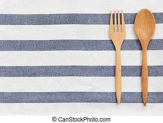 kitchen utensil on tablecloth background
