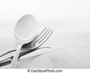 kitchen utensil - knife and fork on white plate