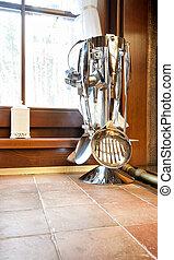 Kitchen utensil - Metal kitchen utensil on rack near window