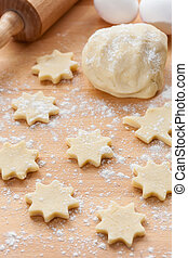 Kitchen utensil with raw Christmas cookies