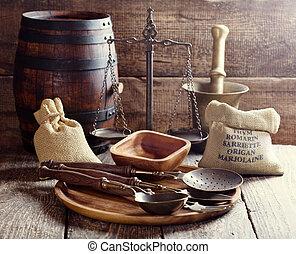 kitchen utensils on rustic wooden background