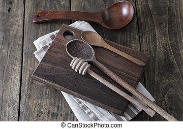 Kitchen utensils on the wooden worktop