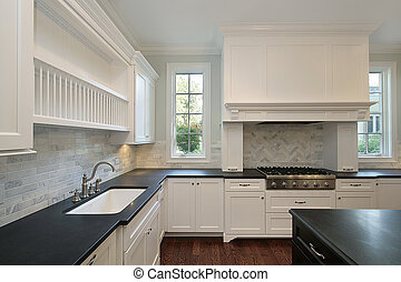 Kitchen with black countertops - Kitchen in new construction...
