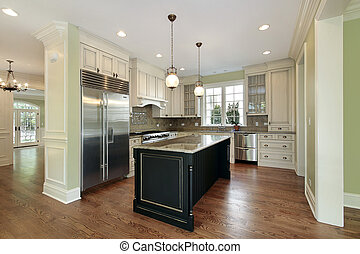 Kitchen in new construction home with black island