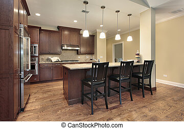 Kitchen with breakfast bar - Kitchen in luxury townhome with...