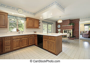 Kitchen with brick fireplace