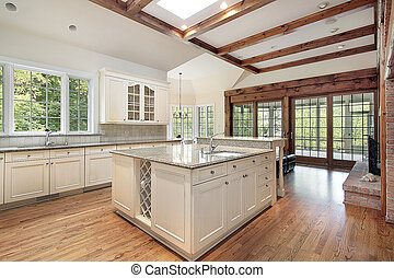Kitchen in new construction home with ceiling wood beams