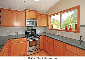 Cherry cabinets, large kitchen in a nice home near Tacoma, WA. Canon 5D Mark II.16mm.