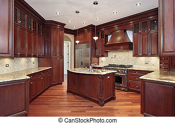 Kitchen in new construction home with cherry wood cabinetry