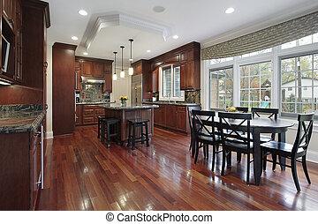 Kitchen with cherry wood flooring