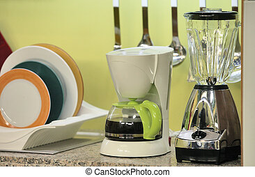 kitchen with coffee maker and fruit press, clean interior...