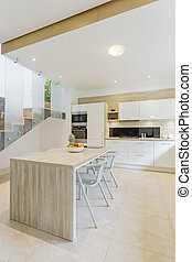 Kitchen with countertop and bar stools