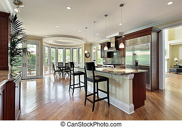 Kitchen with curved eating area - Kitchen in luxury home...