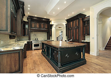 Kitchen with dark cabinetry - Kitchen in new construction...
