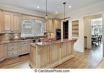 Kitchen in new construction home with double-tiered island