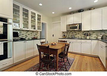 Kitchen with glass cabinets