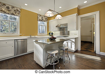 Kitchen with gold walls