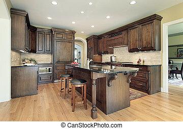 Kitchen with granite island top