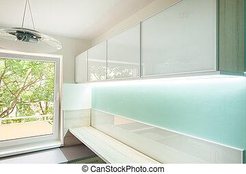 Kitchen with illuminated furniture
