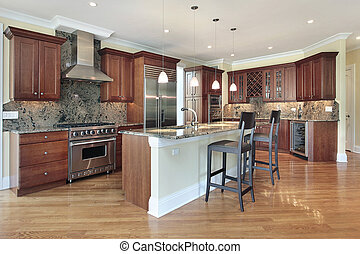 Kitchen with large island - Kitchen in luxury home with...