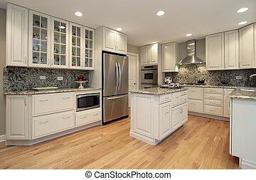 Kitchen in suburban home with light colored cabinetry