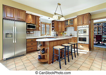 Kitchen with oak cabinetry - Kitchen in modern home with oak...