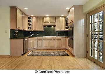 Kitchen with oak cabinetry - Kitchen in remodeled home with...
