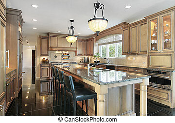 Kitchen with oak wood cabinetry - Kitchen in luxury home ...