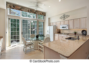 Kitchen in suburban home with sliding doors to patio