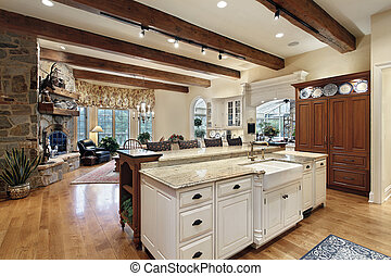 Kitchen with stone fireplace - Kitchen in luxury home with ...
